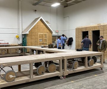 students learning how to build the walls and interior structures of a home