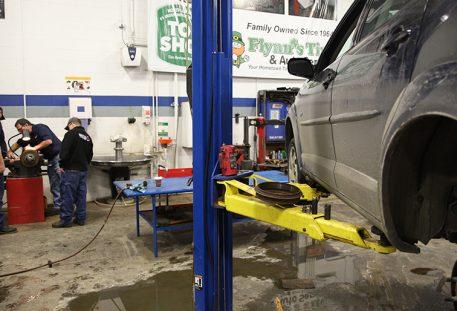Car on lifts, at a mechanic shop