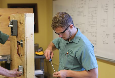 carpentry student working in lab at trade school