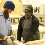 two students training in carpentry