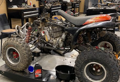 atv being worked on in mechanic shop