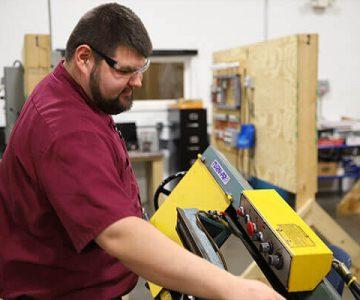 Man works on machinery