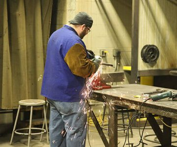 Mna working with welder on metal
