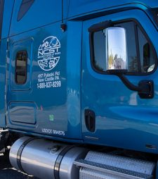 blue semi truck with NCST logo on side