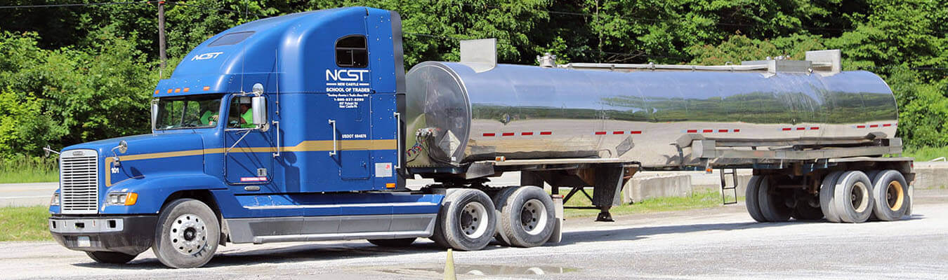 blue Class A tanker truck with NCST logo on side