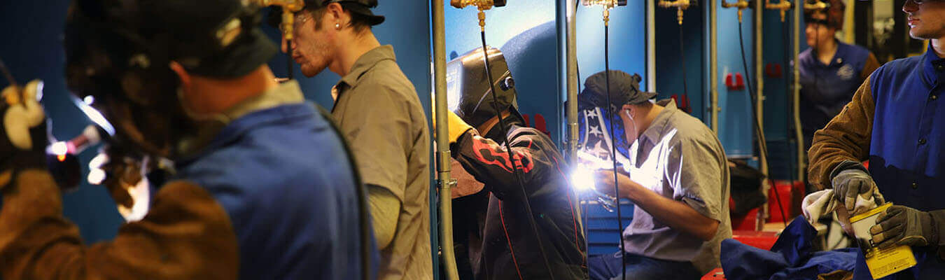 students working inside the welding lab at the East Liverpool Campus
