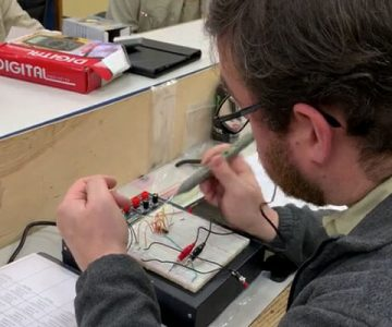 electrical student working on a wiring part in classroom