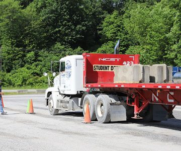 class a cdl flatbed truck taking a test