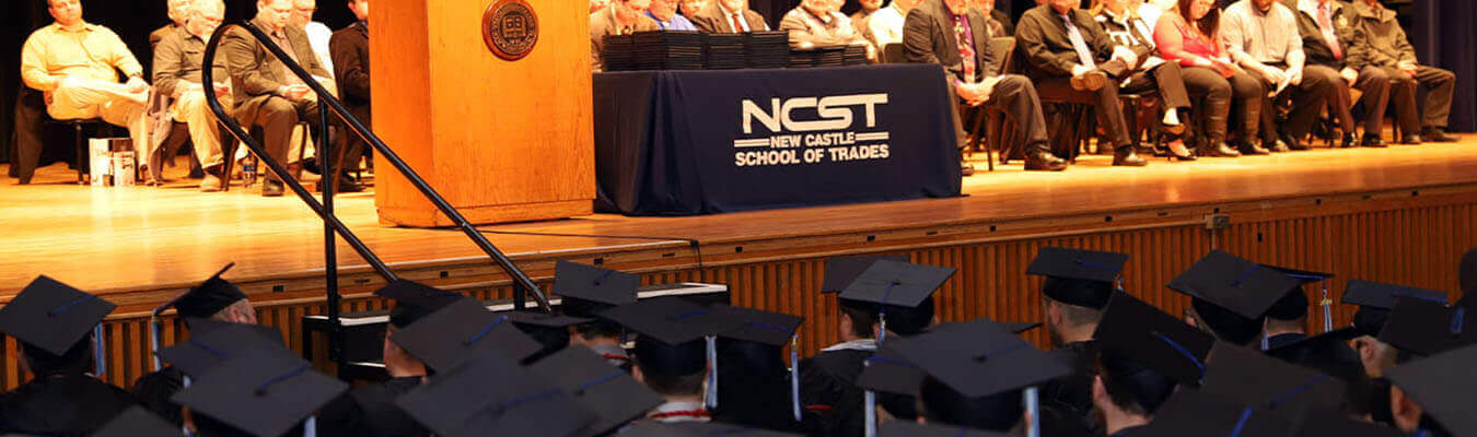 up close photo of an NCST graduation with students in cap and gowns
