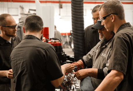 students receiving hands on experience during trade school program
