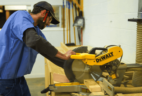 carpenter student cutting wood on table