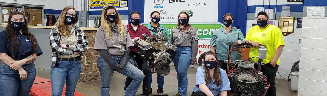 women of New Castle School of Trades in the automotive technology classroom